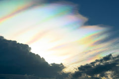 Blue sky with fire rainbow or circumzenithal arc. Nature cloudscape blue sky with fire rainbow or circumzenithal arc Royalty Free Stock Image