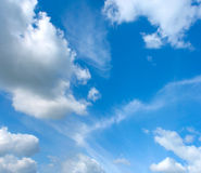 Blue sky with fleecy and cumulus clouds royalty free stock photos