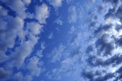 Blue sky, fluffy clouds. Serene blue sky and fluffy, puffy clouds Stock Photo