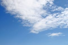Blue sky and fluffy clouds. A bright blue sky with white fluffy clouds Stock Photos