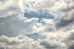 Blue sky with fluffy clouds background, copy space template, cloudy image texture and pattern.  stock photography