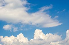 Blue sky with fluffy clouds background, copy space template, cloudy image texture and pattern.  stock photos