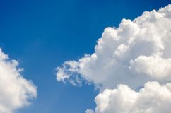 Blue sky with fluffy clouds background, copy space template, cloudy image texture and pattern.  stock image