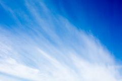 Blue sky with fluffy clouds background Stock Photos