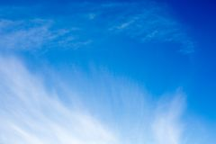 Blue sky with fluffy clouds background Stock Photo
