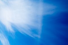 Blue sky with fluffy clouds background Stock Images