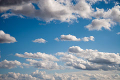 Blue sky with fluffy clouds Stock Photo