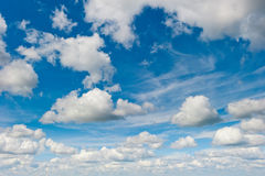 Blue sky and fluffy clouds light Stock Photos