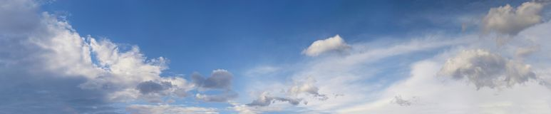 Blue sky with fluffy clouds. Panorama sky background Royalty Free Stock Photo