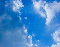 Blue sky and fluffy clouds scene. Bright blue sky and white fluffy clouds scene show how beautiful of nature on our earth royalty free stock photo