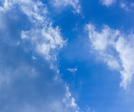 Blue sky and fluffy clouds scene. Bright blue sky and white fluffy clouds scene show how beautiful of nature on our earth royalty free stock photos