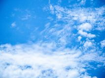Blue sky and fluffy clouds scene. Bright blue sky and white fluffy clouds scene show how beautiful of nature on our earth royalty free stock image
