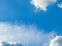 Blue sky and fluffy clouds Royalty Free Stock Photo