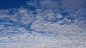 Blue sky with fluffy white clouds Royalty Free Stock Photo