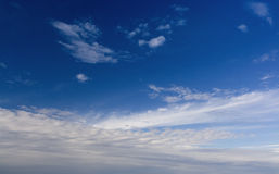 Blue sky with fluffy white clouds Royalty Free Stock Images