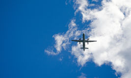 Blue sky fly-over.   Aircraft on a glide path to the airport in St Johns Newfoundland, Canada. Stock Image