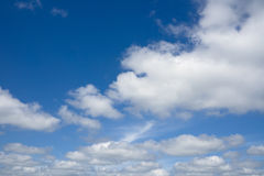 Blue sky with flying clouds over horizon, heaven. Stock Photos