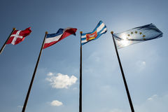 Blue sky with four flags Stock Photography