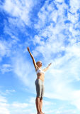 Blue sky and fresh air. Sporty woman enjoying the fresh air and blue skylight Royalty Free Stock Image
