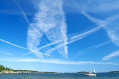 Blue sky full of airplane traces Royalty Free Stock Photography