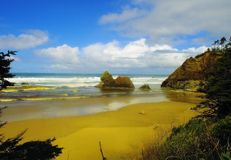 Blue sky and gentle waves. Blue skies and gentle waves along Indian beech on the Oregon coast just south of Seaside Oregon on highway 101 Stock Images