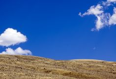 Blue Sky and Golden Land. Blue sky with fluffy white clouds over golden land of Yellowstone National Park, Wyoming stock image
