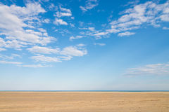 Blue sky and golden sand Stock Image