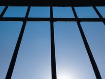 Blue Sky through the grate on the window. stock images