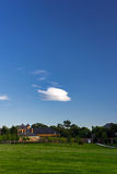 Blue sky and green field. A palace in a park with blue sky and green grass Stock Photography