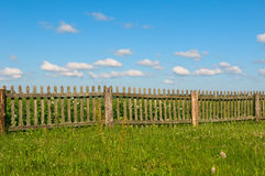 Blue sky, green grass and fence Stock Photo