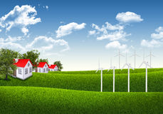 Blue sky, green grass and houses Royalty Free Stock Image