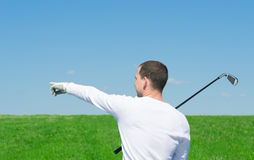 Blue sky and green grass for sports stock photos