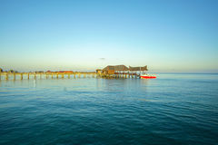 Blue sky and green sea view from mabul island lodge Stock Photo