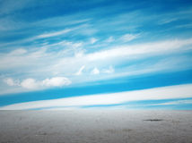 Blue sky and grey floo Royalty Free Stock Photos