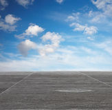 Blue sky and grey floor Stock Photography