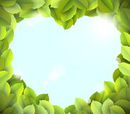Blue sky in heart frame from green leaves Royalty Free Stock Images