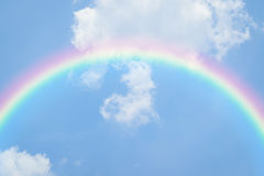 Blue sky heart with rainbow. Nature heart cloudscape with blue sky and white cloud with rainbow Stock Images
