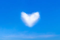 Blue sky and a heart shape cloud Stock Photos