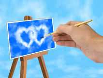 Blue sky and heart-shaped clouds on easel Royalty Free Stock Photo