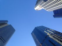 Blue sky and high rise financial buildings Royalty Free Stock Photo