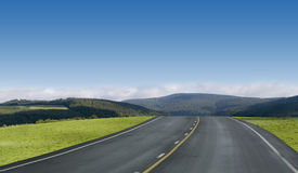 Blue sky highway. Through the green mountains of Germany royalty free stock image