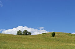 Blue Sky Hillside Stock Photo