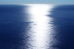 Blue sky horizon bird view with sun reflexion. White line Royalty Free Stock Photography
