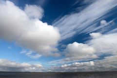 Blue sky with huge fluffy clouds closeup royalty free stock images