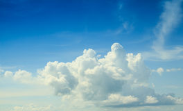 Blue sky and huge white clouds Stock Image