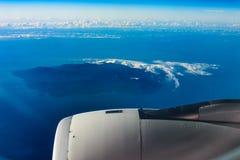Blue sky, island, sea and jet engine stock photo