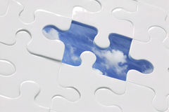 Blue Sky Jigsaw. White jigsaw with piece missing and sky Background; CP for missing piece included Stock Photos