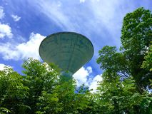Blue sky with large water tank Stock Images