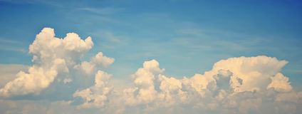 Blue sky with large white clouds. Background with blue sky in which large swirling white clouds Stock Photography