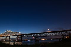 Blue sky and light trails along the Mississippi River in Baton Rouge royalty free stock photos